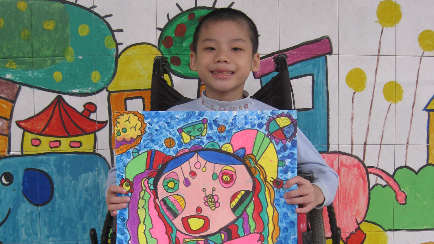 Wu Zhenhao at 8. Zhenhao, whose art training was funded by OneSky, was orphaned as an infant and joined OneSky's programs at the age of four months.