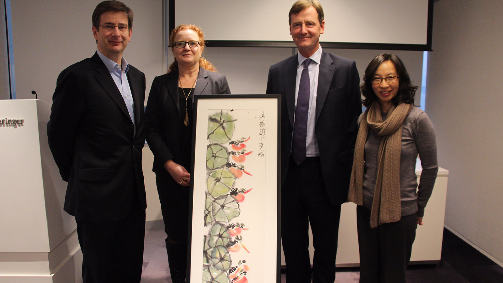 Freshfields Partner William Robinson and Asia Regional Managing Partner Robert Ashworth, along with OneSky's Chief Development Officer Natalie Campion, and Carmen Lau, Director of Development Asia celebrating Freshfields Bruckhaus Deringer's 10-year support of OneSky's work.