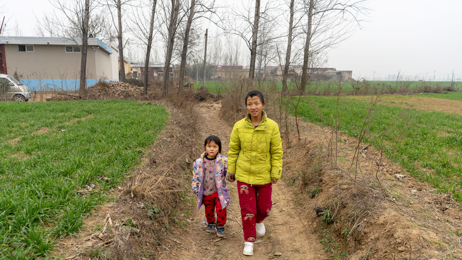 Zhenzhen's mother walks her to class