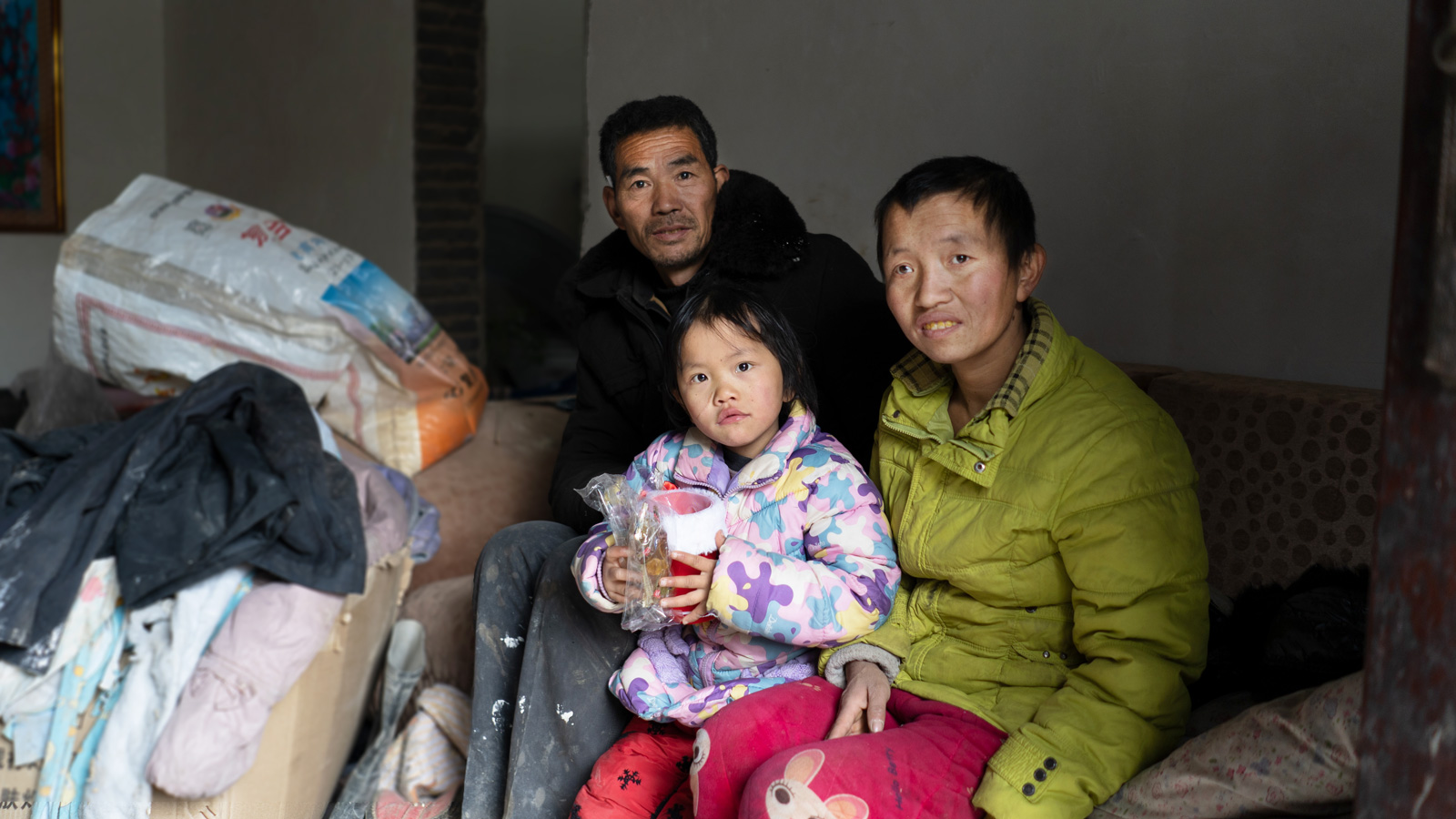 Zhenzhen and her mom and dad at home