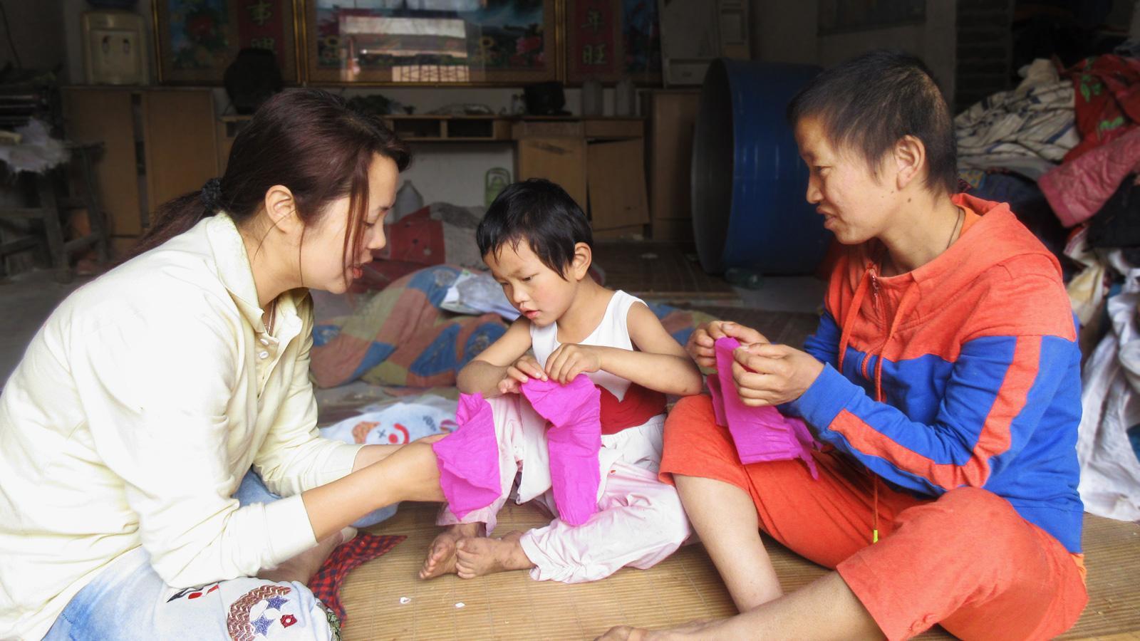 Zhenzhen with her teacher and mother