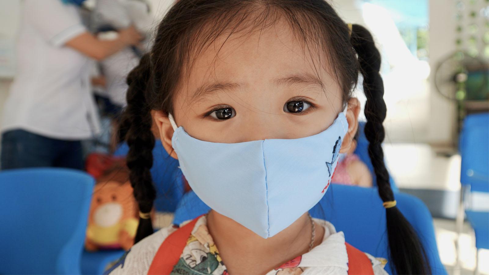 vietnamese child in mask